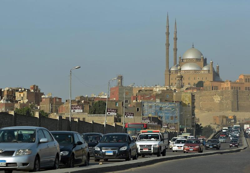 Egyptian motorists drive past the Mohammed Ali mosque in Cairo on March 11, 2013