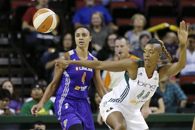 Seattle Storm's Ashley Robinson, right, and Phoenix Mercury's Candice Dupree watch a loose ball in the first half of a WNBA basketball game on Thursday, Aug. 1, 2013, in Seattle. (AP Photo/Elaine Thompson)