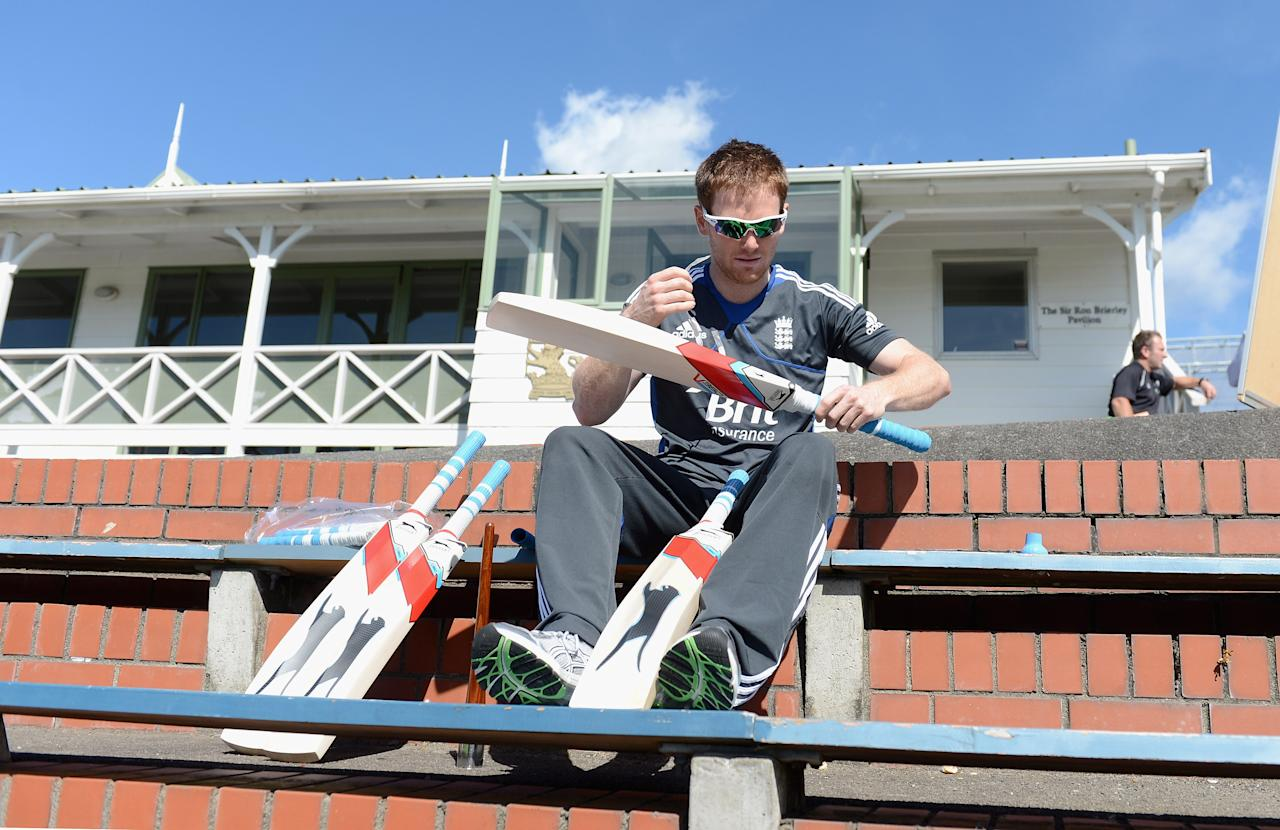 WELLINGTON, NEW ZEALAND - FEBRUARY 14:  Eoin Morgan of England regrips his bats during a England nets session at Basin Reserve on February 14, 2013 in Wellington, New Zealand.  (Photo by Gareth Copley/Getty Images)