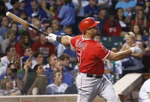 Los Angeles Angels' Albert Pujols watches his two-run home run off Chicago Cubs starting pitcher Jeff Samardzija during the fifth inning of an interleague baseball game Wednesday, July 10, 2013, in Chicago. (AP Photo/Charles Rex Arbogast)