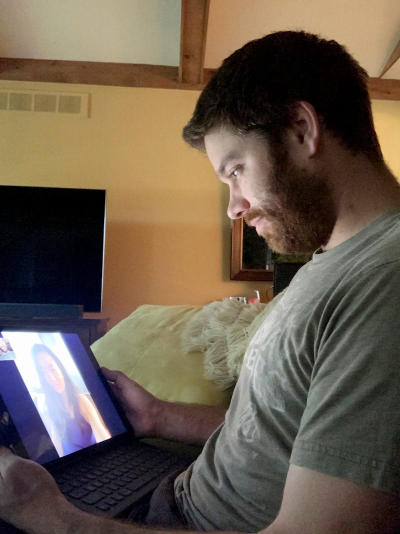 David Goodrich, 29, of Troy, Michigan, FaceTimes with his girlfriend, Danielle Fan, 29, who lives in Windsor, Canada, in June 2020. Canada-U.S. border restrictions due to COVID keep them from visiting each other.