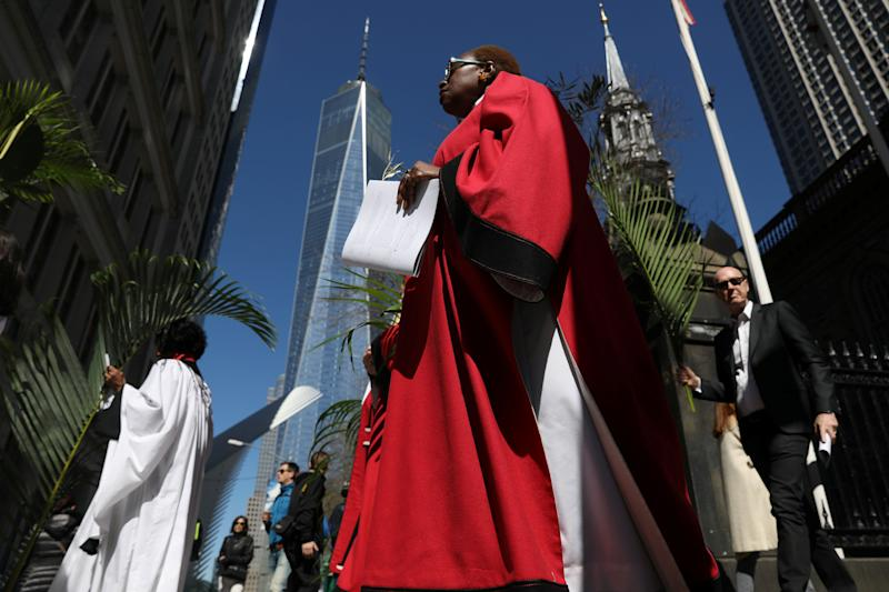Worshippers walk with palms during a Palm Sunday procession from St. Paul's Chapel in Manhattan on April 9, 2017. (Photo: Shannon Stapleton / Reuters)