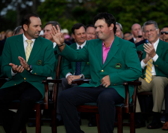 <p> Former Masters champion Sergio Garcia, left, of Spain, speaks with Patrick Reed's after his win at the Masters golf tournament Sunday, April 8, 2018, in Augusta, Ga. (AP Photo/Chris Carlson) </p>