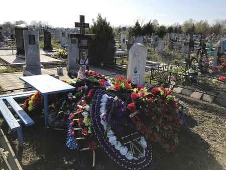 A view shows the grave of Russian military contractor Vladimir Plutinsky at a cemetery in Kropotkin