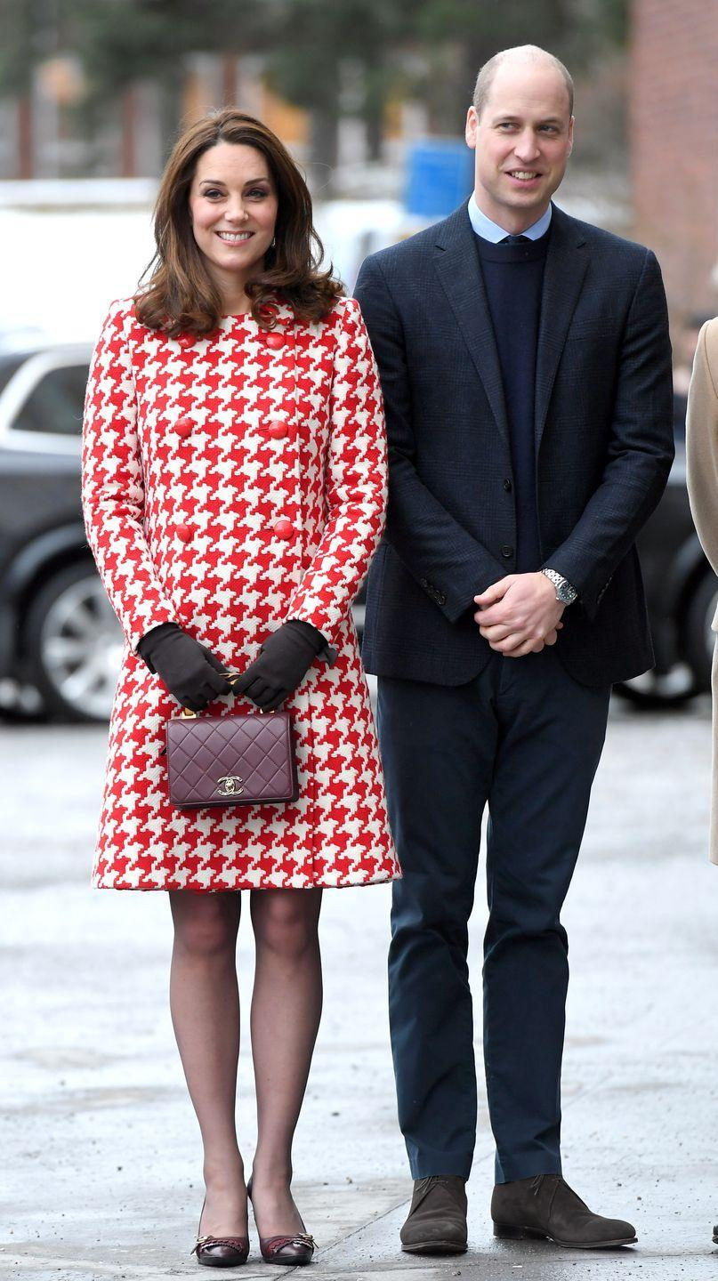 <p>For day two of the royal tour of Sweden, Kate wore a red-and-white houndstooth coat by Catherine Walker paired with brown gloves, a Chanel bag and earrings by Swedish designer In2Design</p>