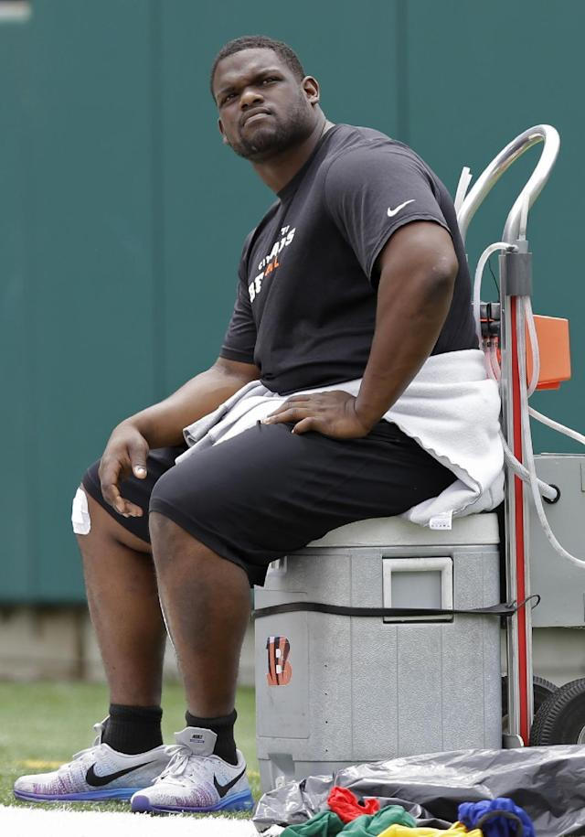FILE - In this June 11, 2014, Cincinnati Bengals defensive tackle Geno Atkins rests during a mandatory NFL football minicamp in Cincinnati. Atkins, who missed most of last season with a knee injury, is expected to be ready at some point when training camp opens this Thursday. (AP Photo/Al Behrman, File)