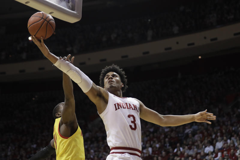 Indiana's Justin Smith (3) shoots against Maryland's Darryl Morsell (11) during the first half of an NCAA college basketball game, Sunday, Jan. 26, 2020, in Bloomington, Ind. (AP Photo/Darron Cummings)