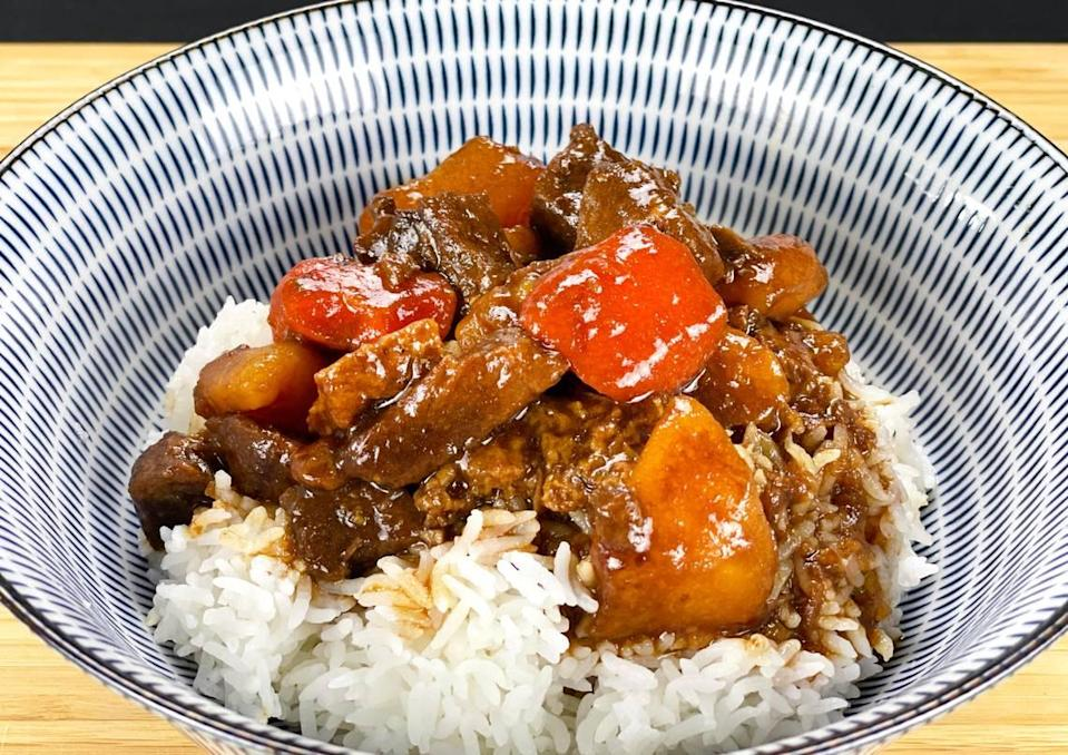 The Beef Stew Rice Bowl at Sun's Kitchen is a hearty dish containing braised beef, potatoes, carrots and a variety of spices.