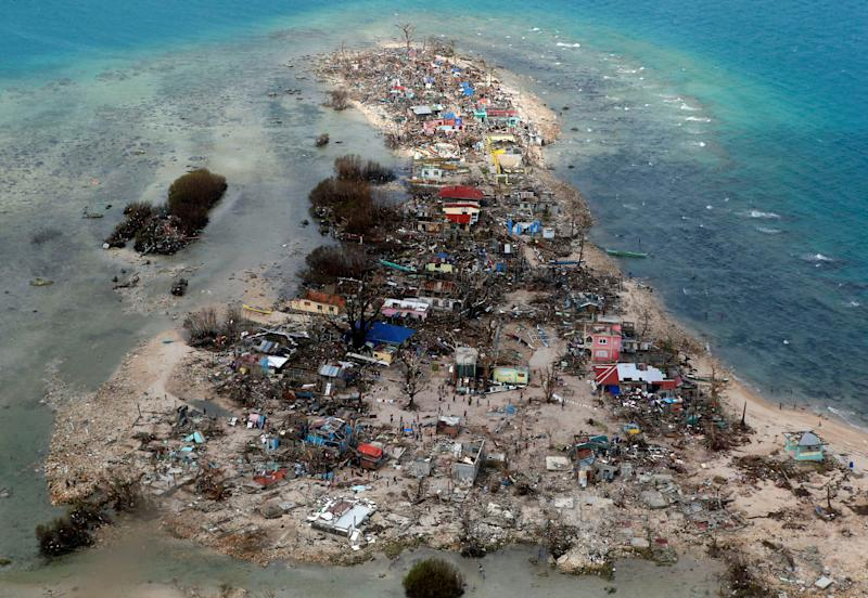 File Photo: An aerial view of a coastal town devastated by super Typhoon Haiyan in Samar province, Philippines, November 11, 2013. REUTERS/Erik De Castro