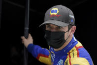 Alexander Rossi watches from his pit box during testing at the Indianapolis Motor Speedway, Thursday, April 8, 2021, in Indianapolis. (AP Photo/Darron Cummings)