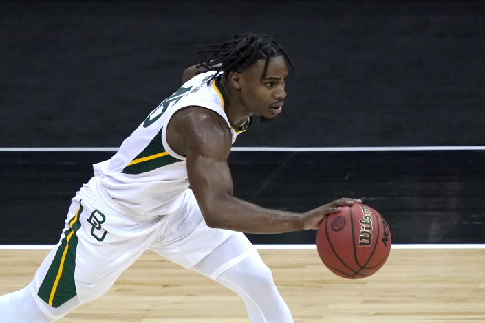 FILE - In this March 11, 2011, file photo, Baylor's Davion Mitchell drives during the second half of the team's NCAA college basketball game against Kansas State in the second round of the Big 12 men's tournament in Kansas City, Mo. Mitchell was selected by the Sacramento Kings in the NBA draft Thursday, July 29, 2021. (AP Photo/Charlie Riedel, File)https://epix.ap.org/#