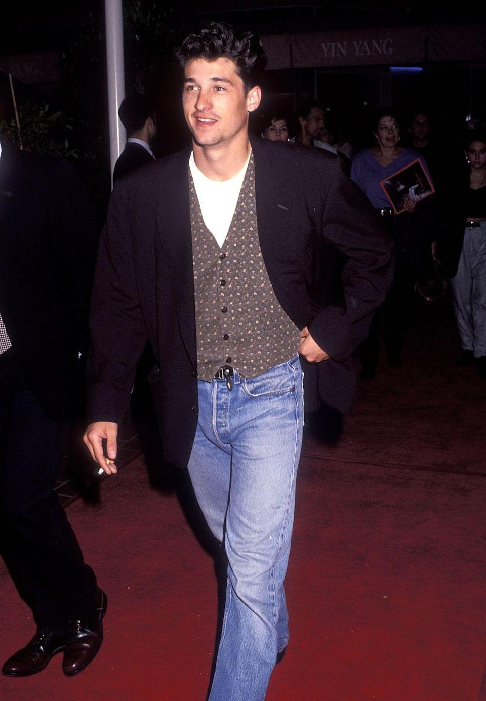 <p>Wearing a suit vest without a jacket or with a jacket that doesn't match is generally something we'd keep back in the archives. But if you ditched the vest and opted for the tee under a cardigan, you'd be 2021 approved.</p>