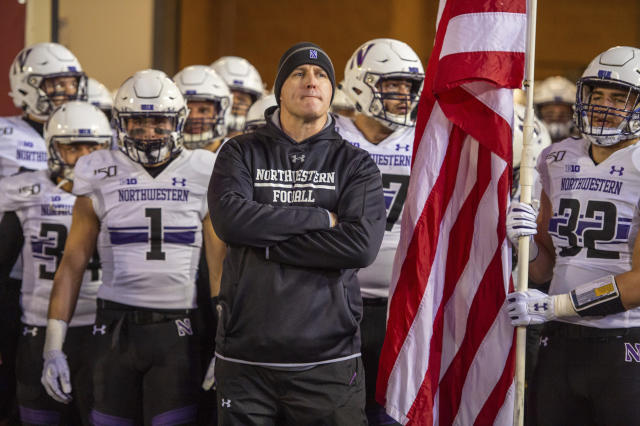 Northwestern head coach Pat Fitzgerald waits with the team to take the field before an NCAA college football game against Indiana, Saturday, Nov. 2, 2019, in Bloomington, Ind. Indiana won 34-3. (AP Photo/Doug McSchooler)