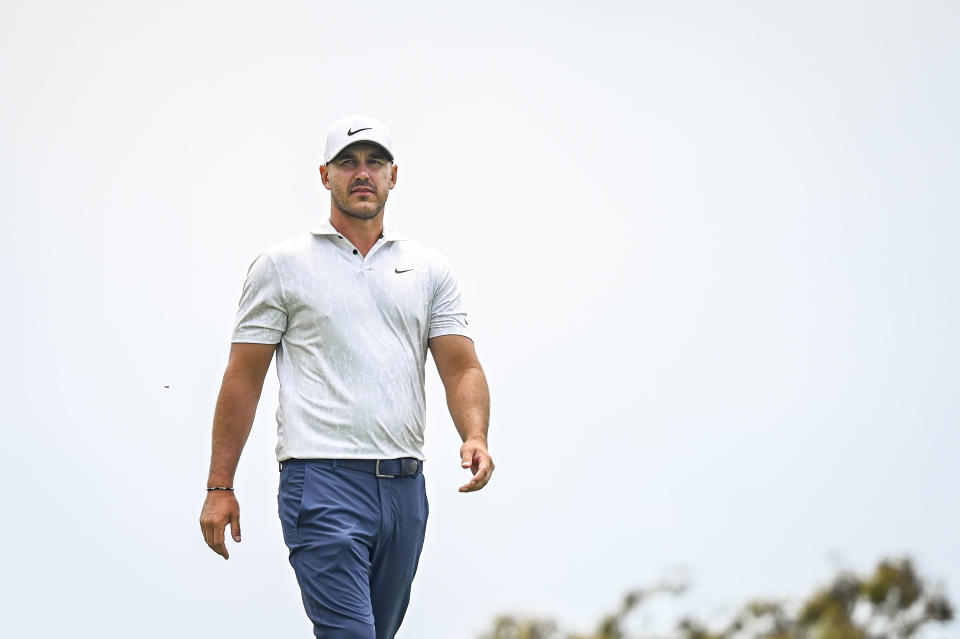Brooks Koepka walks to the second hole tee during the first round of the 121st U.S. Open