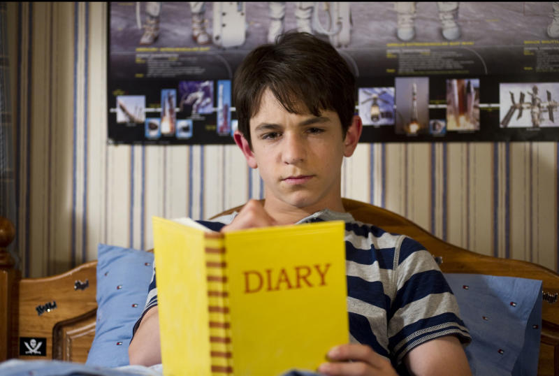 """This undated film image released by 20th Century Fox shows Zachary Gordon in a scene from """"Diary of a Wimpy Kid: Dog Days."""" (AP Photo/20th Century Fox, Diyah Pera)"""
