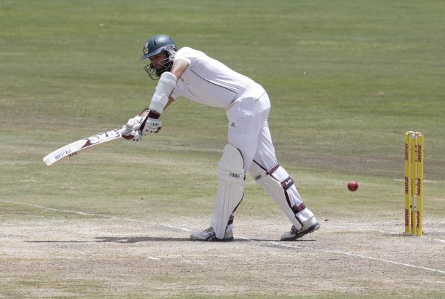 South Africa's Hashim Amla plays a shot during the fourth day of their first cricket test match against Australia in Pretoria February 15, 2014. REUTERS/Mike Hutchings (SOUTH AFRICA - Tags: SPORT CRICKET)