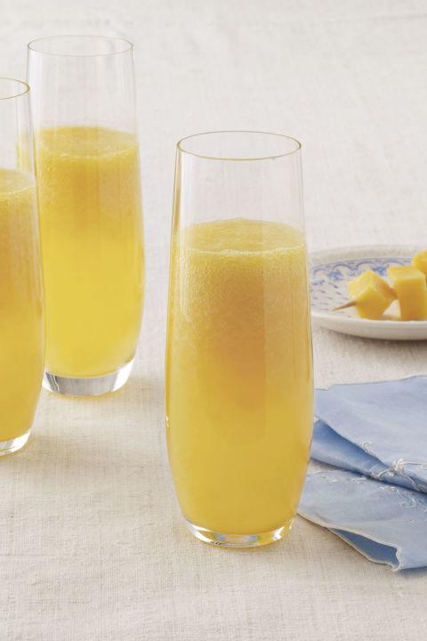 "<p>This cocktail recipe is not only delicious but simple thanks to its two ingredients-mangoes and champagne. </p><p><a rel=""nofollow"" href=""http://www.countryliving.com/food-drinks/recipes/a3640/mango-mimosa-recipe-clv0511/""><strong>Get the recipe.</strong></a><br></p>"