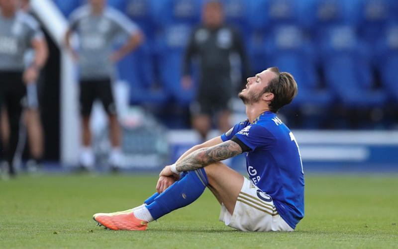 James Maddison sits disconsolate on the ground - GETTY IMAGES