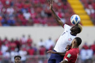 United State´s Gyasi Zardes, top, and Panama's Eric Davis head for the ball during a qualifying soccer match for the FIFA World Cup Qatar 2022 at Rommel Fernandez stadium, Panama city, Panama, Sunday, Oct. 10, 2021. (AP Photo/Arnulfo Franco)
