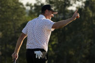 Justin Rose, of England, reacts after a birdie on the 18th green during the final round of the Masters golf tournament on Sunday, April 11, 2021, in Augusta, Ga. (AP Photo/David J. Phillip)