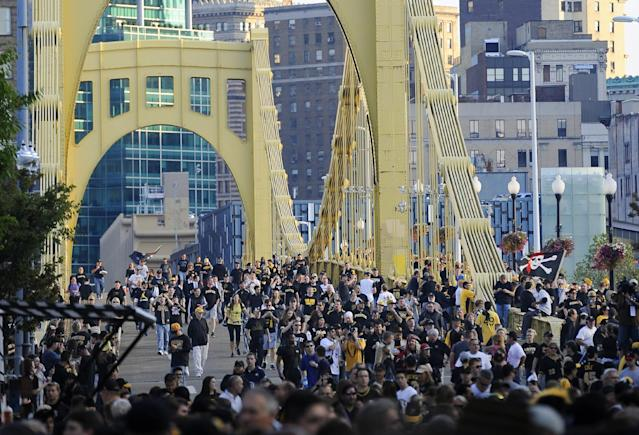 People cross the Roberto Clemente Bridge on their way to the NL wild-card playoff baseball game between the Pittsburgh Pirates and the Cincinnati Reds on Tuesday, Oct. 1, 2013, in Pittsburgh. The Pirates were making their first post-season appearance since 1992. (AP Photo/Don Wright)
