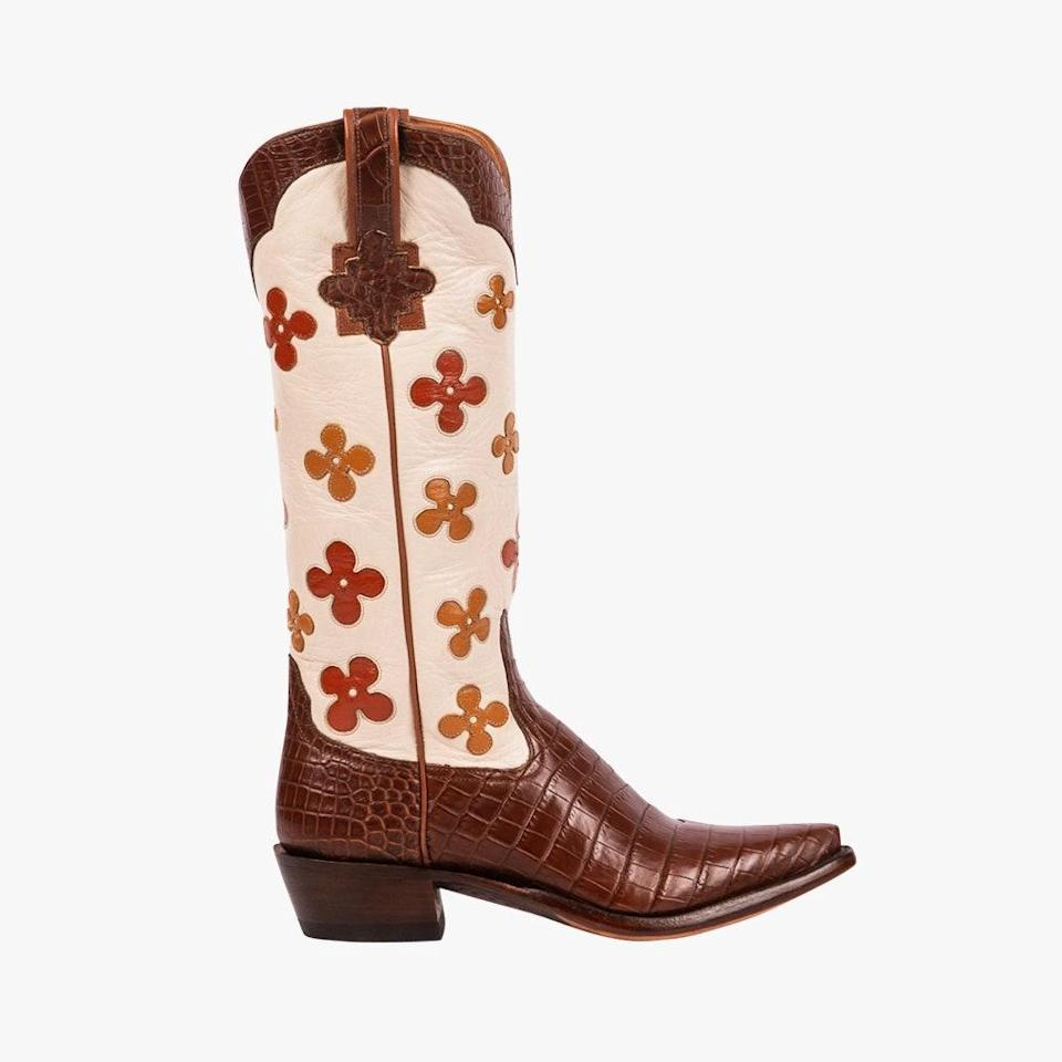 """Quatrefoil-shaped windows can be found at Dallas's Rosewood Mansion on Turtle Creek. And so it was the perfect motif for bespoke bootmakers Miron Crosby to sprinkle on a boot, <a href=""""https://www.vogue.com/slideshow/miron-crosby-cowboy-boots-dallas-prabal-gurung-barbara-bush-tina-craig-first-lady-laura-bush?mbid=synd_yahoo_rss"""" rel=""""nofollow noopener"""" target=""""_blank"""" data-ylk=""""slk:made especially"""" class=""""link rapid-noclick-resp"""">made especially</a> for the hotel. $3425, MIRON CROSBY. <a href=""""https://mironcrosby.com/products/womens-mansion-boot"""" rel=""""nofollow noopener"""" target=""""_blank"""" data-ylk=""""slk:Get it now!"""" class=""""link rapid-noclick-resp"""">Get it now!</a>"""