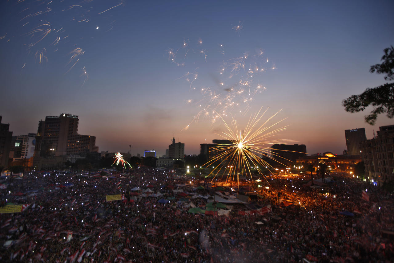 Fireworks illuminate Tahrir Square in Cairo, Egypt, as Egyptians gather to celebrate Mohammed Morsi's presidential win Sunday, June 24, 2012. Mohammed Morsi was declared Egypt's first Islamist president on Sunday after the freest elections in the country's history, narrowly defeating Hosni Mubarak's last Prime Minister Ahmed Shafiq in a race that raised political tensions in Egypt to a fever pitch.(AP Photo/Khalil Hamra)
