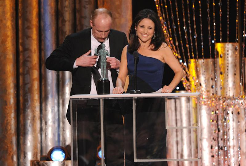 """Matt Walsh, left, joins Julia Louis-Dreyfus on stage as she accepts the award for outstanding performance by a female actor in a comedy series for """"Veep"""" at the 20th annual Screen Actors Guild Awards at the Shrine Auditorium on Saturday, Jan. 18, 2014, in Los Angeles. (Photo by Frank Micelotta/Invision/AP)"""
