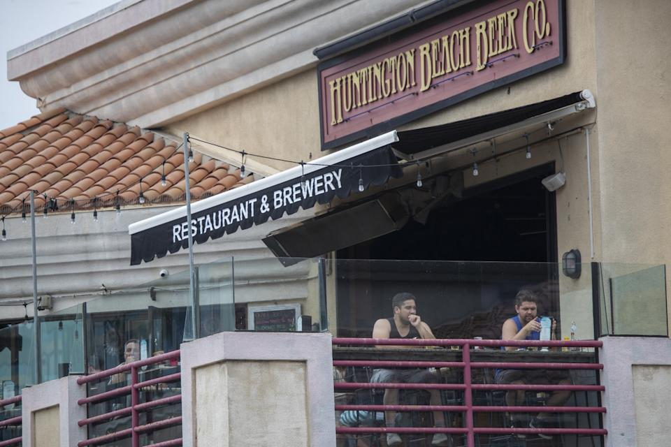 Patrons relax at Huntington Beach Beer Co. Restaurant & Brewery