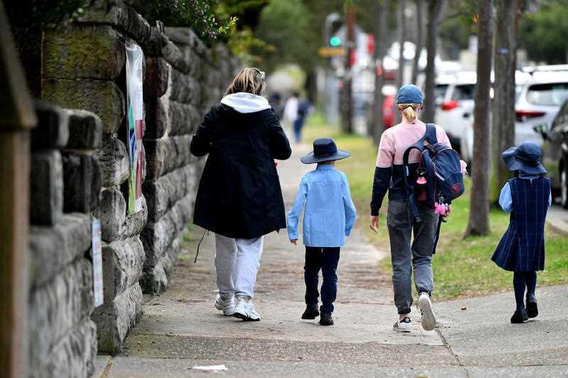 Parents collect children at St Charle's Primary School at Waverley in Sydney.