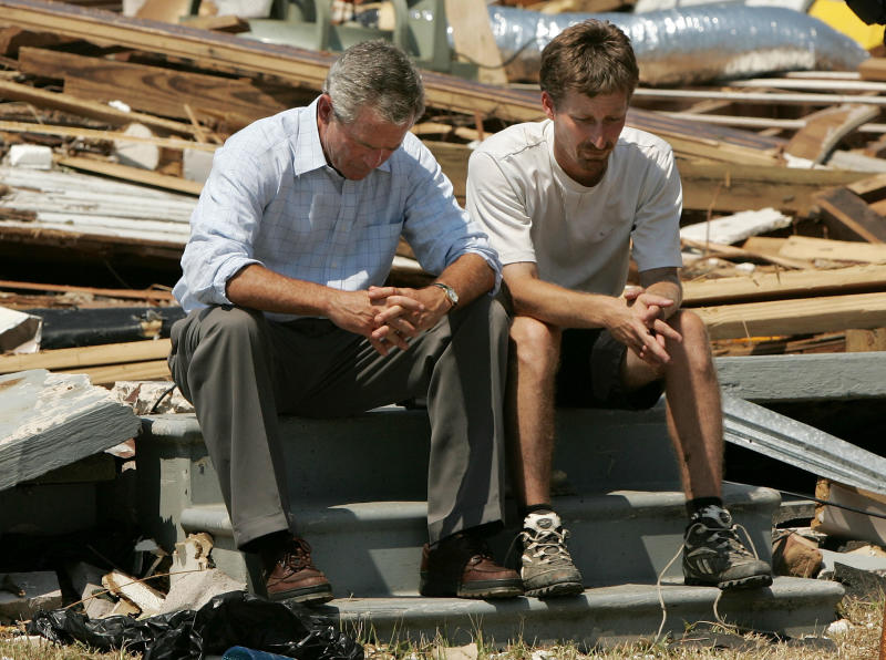 George Bush sitting with Biloxi resident Patrick Wright, whose home was destroyed during Hurricane Katrina in 2005. (Win McNamee via Getty Images)