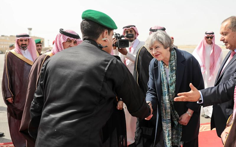 Theresa May, U.K. prime minister, shakes hands with a member of the welcoming delegation following her arrival at King Khalid International Airport in Riyadh - Credit: Simon Dawson/Bloomberg