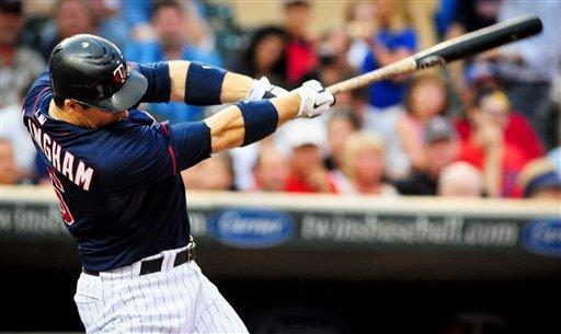 Minnesota Twins' Josh Willingham connects on a solo home run in the second inning of a baseball game against the Okland Athletics on Friday, July 13, 2012, in Minneapolis. Willingham hit another home run in the fourth inning. (AP Photo/St. Paul Pioneer Press, Ben Garvin) MINNEAPOLIS OUT