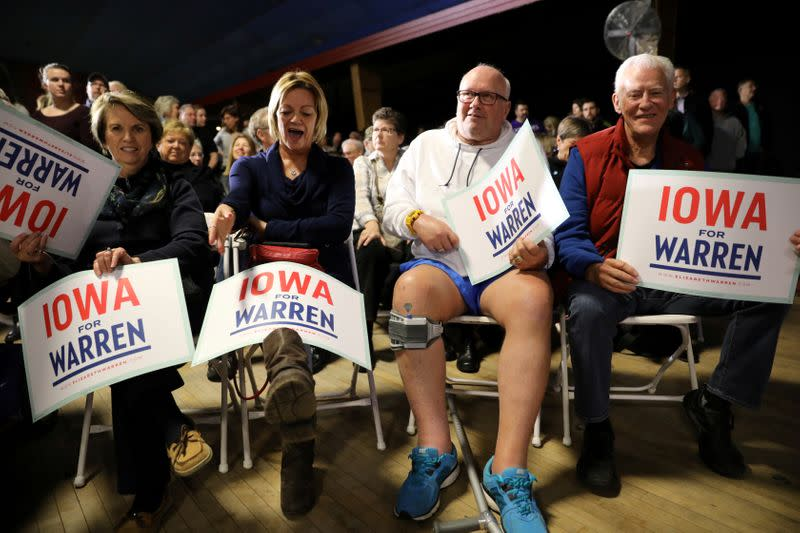 FILE PHOTO: Voters wait to hear U.S. Democratic presidential candidate Sen. Elizabeth Warren speak at a town hall event in West Des Moines