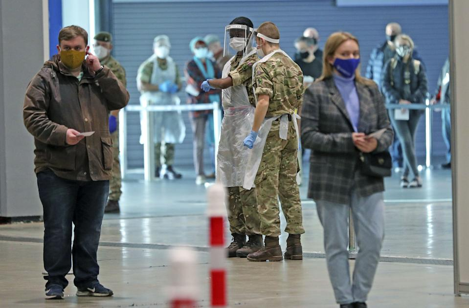 Soldiers direct people at The Exhibition Centre in Liverpool, which has been set up as a testing centre as part of the mass Covid-19 testing in Liverpool.