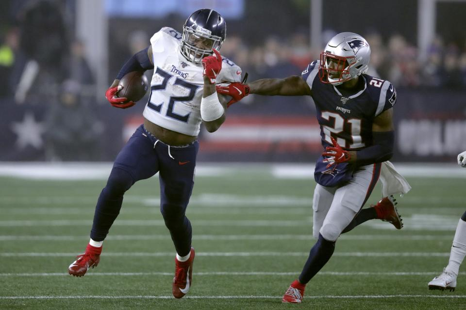 Tennessee Titans running back Derrick Henry runs from New England Patriots safety Duron Harmon. (AP Photo/Charles Krupa)