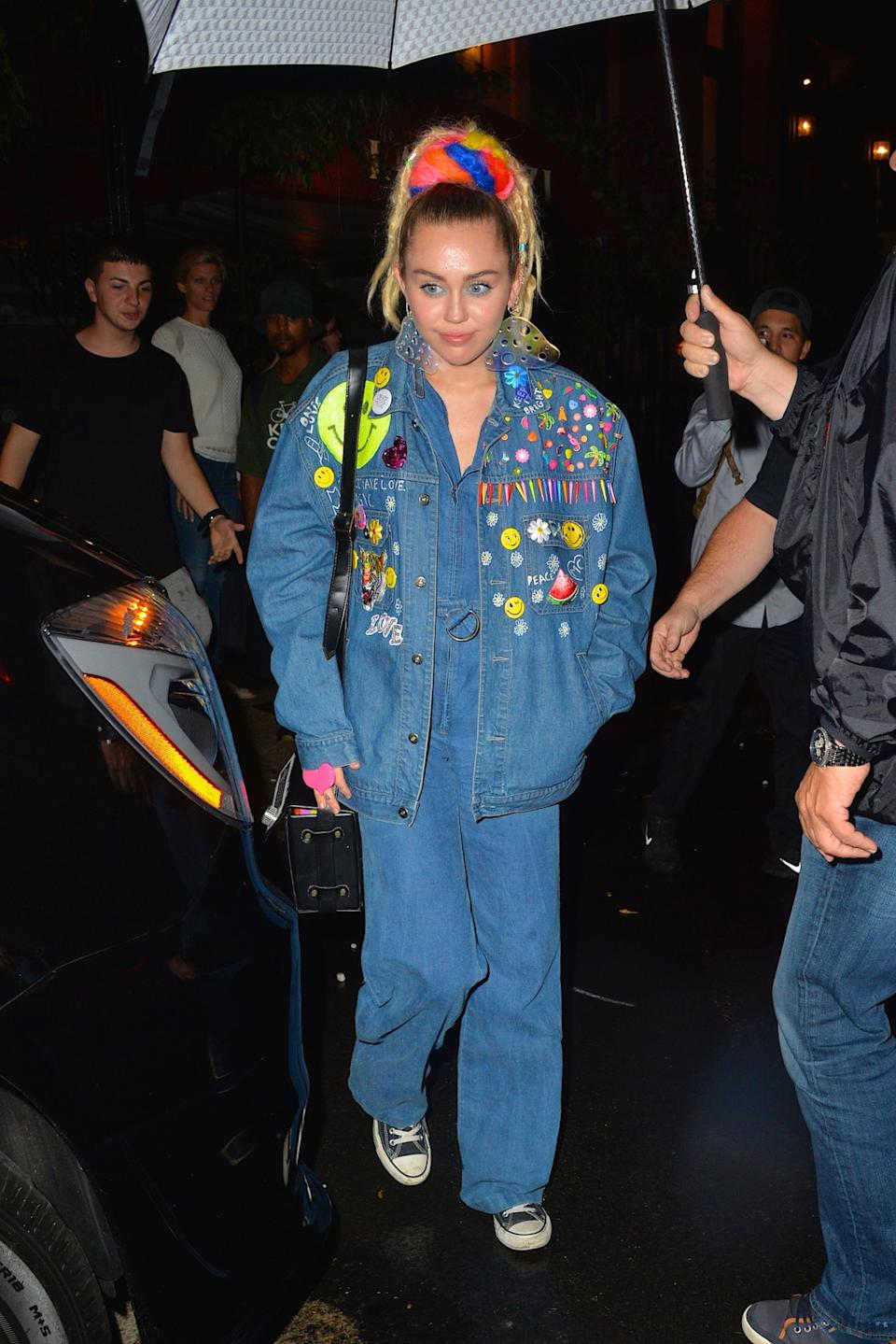 Miley Cyrus Wore A Denim Tuxedo Covered In Smiley Faces Flowers