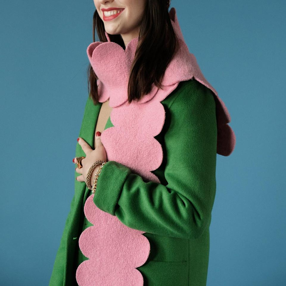 "This whimsical, 100% wool, scalloped-edge scarf from <a href=""https://www.glamour.com/story/frances-valentine-kate-spade-most-iconic-bag?mbid=synd_yahoo_rss"" rel=""nofollow noopener"" target=""_blank"" data-ylk=""slk:Frances Valentine"" class=""link rapid-noclick-resp"">Frances Valentine</a> is the perfect cold-weather accessory that elevates any look. It comes in pink, red, and blue (in case you want to color-coordinate to Hanukkah). $138, Frances Valentine. <a href=""https://francesvalentine.com/collections/apparel/products/scallop-scarf-pink"" rel=""nofollow noopener"" target=""_blank"" data-ylk=""slk:Get it now!"" class=""link rapid-noclick-resp"">Get it now!</a>"