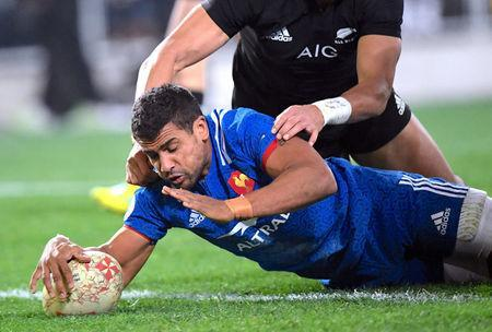 Rugby Union - June Internationals - New Zealand vs France - Forsyth Barr Stadium, Dunedin, New Zealand - June 23, 2018 - Wesley Fofana of France scores a try as he is tackled by Reiko Ioane of New Zealand. REUTERS/Ross Setford