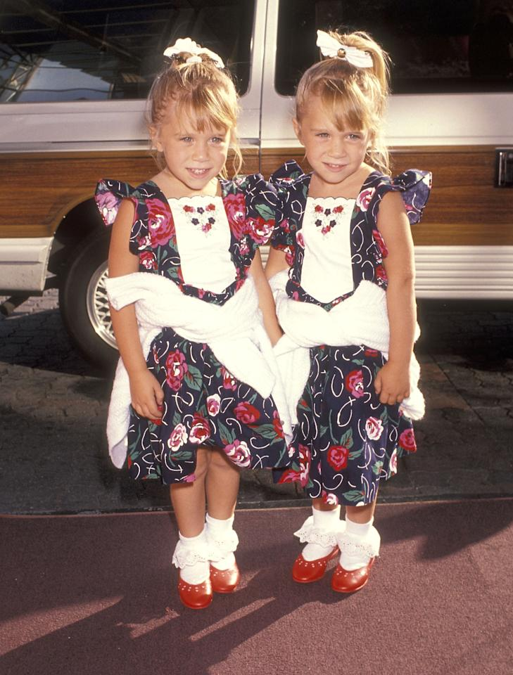<p>Clad in frilly socks, hair bows and floral dresses, the twins served up all the cuteness at the ABC Summer Press Tour. <em>[Photo: Getty]</em> </p>
