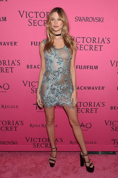 <p>Behati Prinsloo channeled Kate Moss in a little slip dress, choker necklace, and really high platform heels. </p>