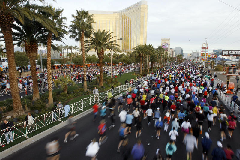 FILE - In this Dec. 5, 2010 file photo, runners fill the Las Vegas Strip during the Las Vegas marathon in Las Vegas. City officials and Las Vegas Rock 'n' Roll Marathon organizers are calling for a date shift to Nov. 17 a chance to raise the profile of the race and remove a weekend conflict with another big event in town.  The race was held last year on the first Sunday in December. (AP Photo/Isaac Brekken, File)