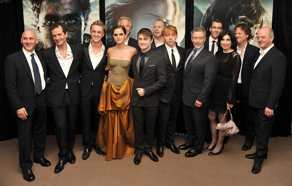 """NEW YORK, NY – JULY 11: (L-R) Jeff Robinov, David Heyman, Tom Felton, Emma Watson, Alan Rickman, Daniel Radcliffe, David Yates, Rupert Grint, Barry M. Meyer, Matthew Lewis, Sue Kroll, Chris Columbus and David Barron attend the New York premiere of """"Harry Potter And The Deathly Hallows: Part 2"""" at Avery Fisher Hall, Lincoln Center on July 11, 2011 in New York City. (Photo by Stephen Lovekin/Getty Images)"""