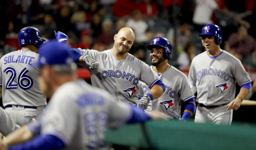 Toronto Blue Jays' Steve Pearce, second from left, celebrates at the dugout after his three-run home run against the Los Angeles Angels during the ninth inning of a baseball game in Anaheim, Calif., Saturday, June 23, 2018. (AP Photo/Chris Carlson)