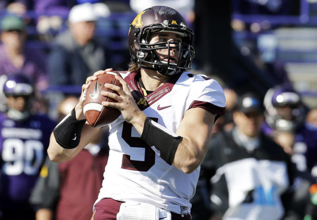 FILE - In this Oct. 19, 2013, file photo, Minnesota quarterback Philip Nelson looks to a throw during the first half of an NCAA college football game against Northwestern in Evanston, Ill. Former Minnesota Gophers quarterback Nelson was jailed following an altercation in Mankato early Sunday, May 11, 2014, that sent a former Minnesota State, Mankato, linebacker to the hospital in critical condition. (AP Photo/Nam Y. Huh, File)