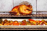 "Roasting a chicken directly on your oven rack gives it a crispier skin on all sides. Add a tray of vegetables underneath it to catch all the delicious drippings and you'll never look back. <a href=""https://www.epicurious.com/recipes/food/views/rack-roasted-chicken-56389991?mbid=synd_yahoo_rss"" rel=""nofollow noopener"" target=""_blank"" data-ylk=""slk:See recipe."" class=""link rapid-noclick-resp"">See recipe.</a>"