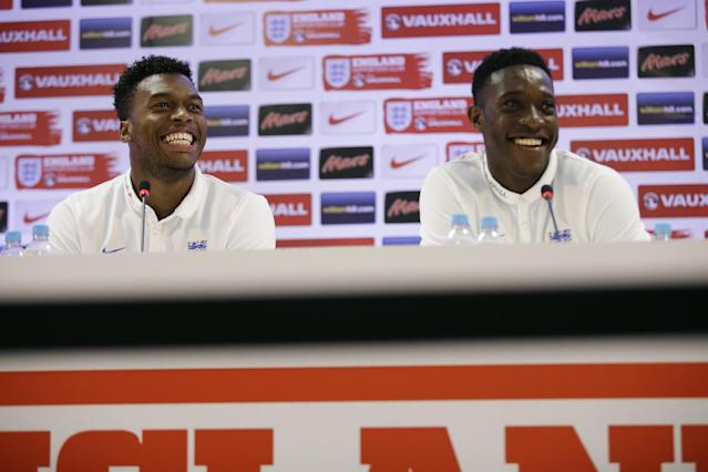 England national soccer team players Daniel Sturridge, left, and Danny Welbeck laugh during a press conference after a squad training session for the 2014 soccer World Cup at the Urca military base in Rio de Janeiro, Brazil, Monday, June 16, 2014. (AP Photo/Matt Dunham)