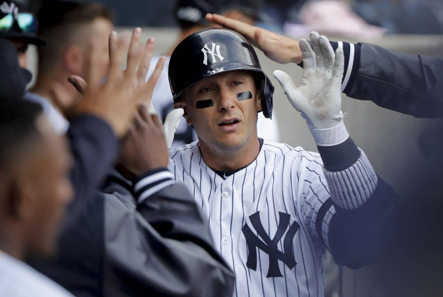 New York Yankees' Troy Tulowitzki is congratulated by teammates after hitting a solo home run against the Baltimore Orioles during the ninth inning of a baseball game, Saturday, March 30, 2019, in New York. The Orioles won 5-3. (AP Photo/Julie Jacobson)
