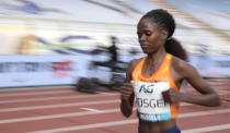 Kenya's Brigid Kosgei during the One Hour Women at the Diamond League Memorial Van Damme athletics event at the King Baudouin stadium in Brussels on Friday, Sept. 4, 2020. (AP Photo/Virginia Mayo)