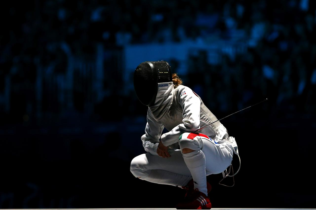 LONDON, ENGLAND - JULY 28:  Valentina Vezzali of Italy reacts after losing a point in her Women's Foil Individual Fencing Semi-Final match against Arianna Errigo of Italy on Day 1 of the London 2012 Olympic Games at ExCeL on July 28, 2012 in London, England.  (Photo by Hannah Johnston/Getty Images)